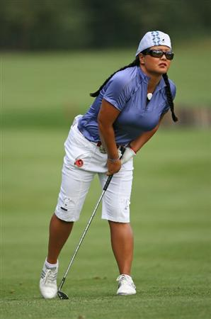 CALGARY, AB - SEPTEMBER 03: Christina Kim of the United States watches her third shot on the ninth hole during the first round of the Canadian Women's Open at Priddis Greens Golf & Country Club on September 3, 2009 in Calgary, Alberta, Canada. (Photo by Hunter Martin/Getty Images)