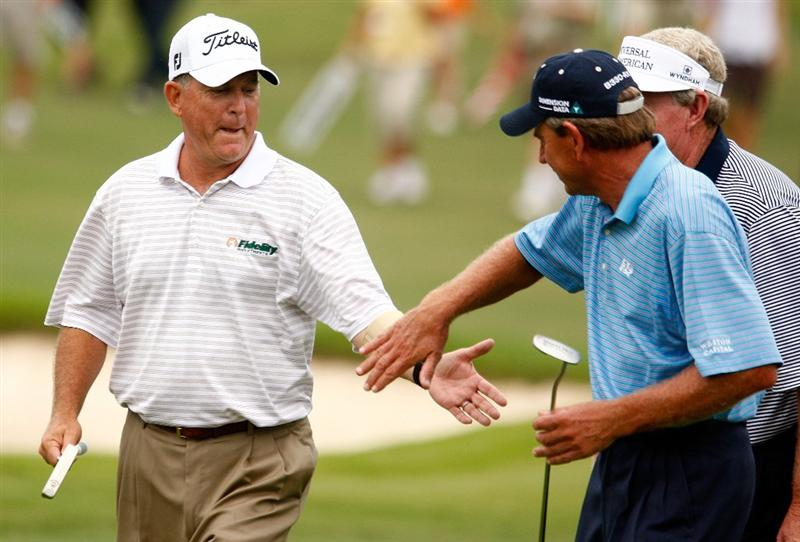 CONOVER, NC - SEPTEMBER 20:  Jay Haas (L)  shakes hands with Nick Price and Andy Bean as he walks to the 18th green during the final round of the Greater Hickory Classic at the Rock Barn Golf & Spa on September 20, 2009 in Conover, North Carolina.  (Photo by Scott Halleran/Getty Images)