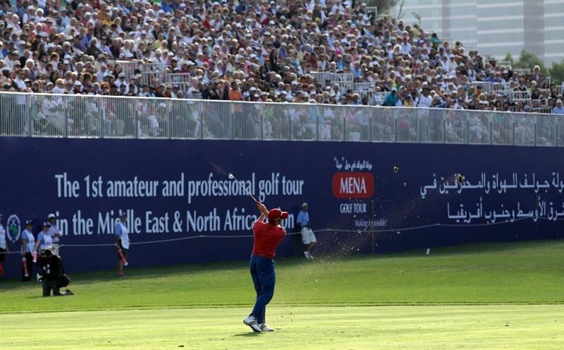DUBAI, UNITED ARAB EMIRATES - FEBRUARY 13:  Sergio Garcia of Spain plays his third shot at the 18th hole during the final round of the 2011 Omega Dubai Desert Classic on the Majilis Course at the Emirates Golf Club on February 13, 2011 in Dubai, United Arab Emirates.  (Photo by David Cannon/Getty Images)