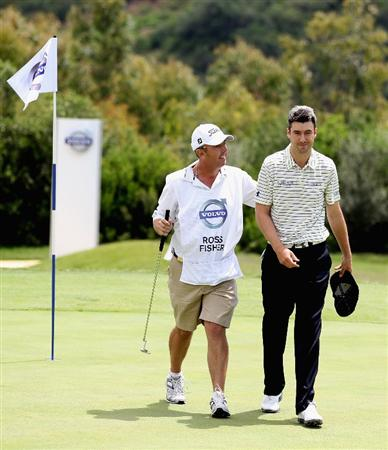 CASARES, SPAIN - MAY 20:  Ross Fisher of England is congratulated by his caddie Phil Morbey during the group stages of the Volvo World Match Play Championship at Finca Cortesin on May 20, 2011 in Casares, Spain.  (Photo by Ross Kinnaird/Getty Images)