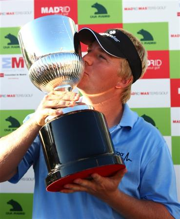 MADRID, SPAIN - OCTOBER 11:  Ross McGowan of England celebrates with the trophy after winning the Final Round of the Madrid Masters at Cantro Nacional De Golf on October 9, 2009 in Madrid, Spain.  (Photo by Ian Walton/Getty Images)