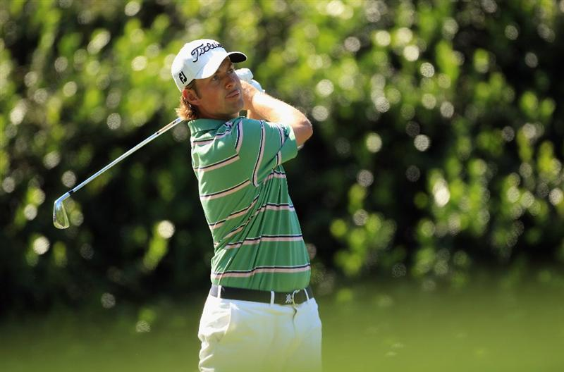 CHARLOTTE, NC - MAY 05:  Webb Simpson watches his tee shot on the 13th hole during the first round of the Wells Fargo Championship at Quail Hollow Club on May 5, 2011 in Charlotte, North Carolina.  (Photo by Streeter Lecka/Getty Images)