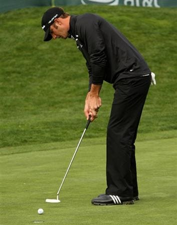 PEBBLE BEACH, CA - FEBRUARY 12: Dustin Johnson makes a birdie putt on the 16th hole to go seven under par during the first round of the the AT&T Pebble Beach National Pro-Am on Pebble Beach Golf Links on February 12, 2009 in Pebble Beach, California. (Photo by Stephen Dunn/Getty Images)