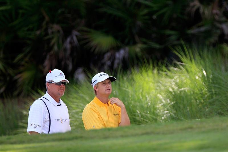 PONTE VEDRA BEACH, FL - MAY 15:  David Toms and caddie Scott Gneiser look on from the tenth hole during the final round of THE PLAYERS Championship held at THE PLAYERS Stadium course at TPC Sawgrass on May 15, 2011 in Ponte Vedra Beach, Florida.  (Photo by Sam Greenwood/Getty Images)