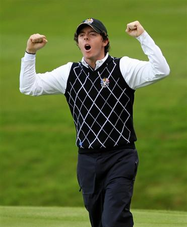 NEWPORT, WALES - OCTOBER 03:  Rory McIlroy of Europe celebrates after team mate Graeme McDowell holed a putt on the 15th green during the  Fourball & Foursome Matches during the 2010 Ryder Cup at the Celtic Manor Resort on October 3, 2010 in Newport, Wales.  (Photo by Jamie Squire/Getty Images)