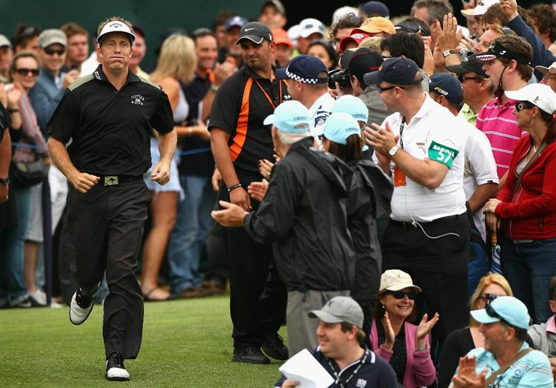 MELBOURNE, AUSTRALIA - NOVEMBER 14:  Stuart Appleby runs to the presention area after winning the Australian Masters at The Victoria Golf Club on November 14, 2010 in Melbourne, Australia.  (Photo by Ryan Pierse/Getty Images)