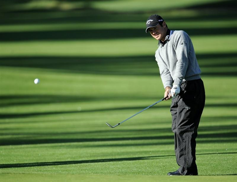 PACIFIC PALISADES, CA - FEBRUARY 17:  Trevor Immelman of South Africa watches his chip shot on the 11th green during the first round of the Northern Trust Open at the Riviera Country Club on February 17, 2011 in Pacific Palisades, California.  (Photo by Harry How/Getty Images)