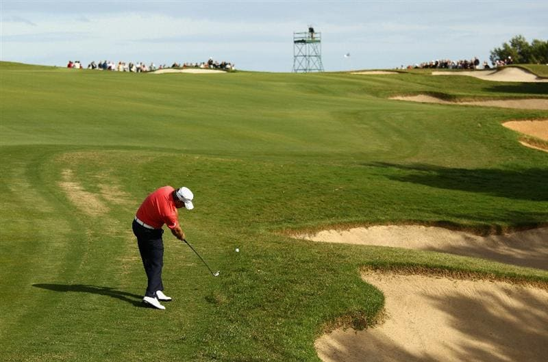 SOTOGRANDE, SPAIN - OCTOBER 30:  Graeme McDowell of Northern Ireland plays into the 11th green during the third round of the Andalucia Valderrama Masters at Club de Golf Valderrama on October 30, 2010 in Sotogrande, Spain.  (Photo by Richard Heathcote/Getty Images)