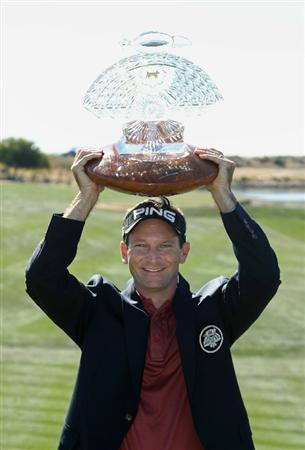 SCOTTSDALE, AZ - FEBRUARY 07:  Mark Wilson poses with the winner's trophy after defeating Jason Dufner (not pictured) in a two hole playoff to win the Waste Management Phoenix Open at TPC Scottsdale on February 7, 2011 in Scottsdale, Arizona.  (Photo by Christian Petersen/Getty Images)