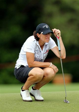KUALA LUMPUR, MALAYSIA - OCTOBER 24:  Juli Inkster of USA lines up a putt on the 16th hole during the Final Round of the Sime Darby LPGA on October 24, 2010 at the Kuala Lumpur Golf and Country Club in Kuala Lumpur, Malaysia. (Photo by Stanley Chou/Getty Images)