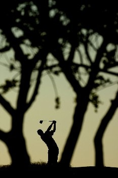 VILAMOURA, PORTUGAL - OCTOBER 19:  Alastair Forsyth of Scotland tee's off at the 3rd in the early morning light during the second round of the Portugal Masters at Oceânico Victoria Clube de Golfe on 19 October, 2007 in Vilamoura, Portugal.  (Photo by Richard Heathcote/Getty Images)