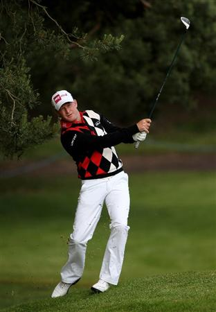 VIRGINIA WATER, ENGLAND - MAY 26:  Jamie Donaldson of Wales hits his approach shot on the 12th hole during the first round of the BMW PGA Championship at Wentworth Club on May 26, 2011 in Virginia Water, England.  (Photo by Andrew Redington/Getty Images)
