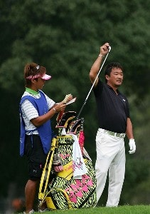 Mitsuhiro Tateyama (R) of Japan waits to hit his second shot on the ninth hole during the first round of the Sony Open at the Waialae Country Club January 10, 2008 in Honolulu, Oahu, Hawaii. PGA TOUR - 2008 Sony Open in Hawaii - First RoundPhoto by Jonathan Ferrey/WireImage.com