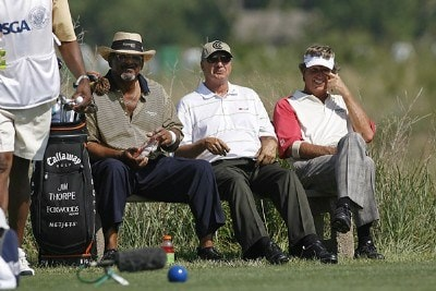 Jim Thorpe, Don Pooley and Dana Quigley have a laugh as they wait on the tee box of hole 4 during the second round of the U.S. Senior Open at Prairie Dunes Country Club in Hutchinson,  Kansas on July 7, 2006.Photo by G. Newman Lowrance/WireImage.com