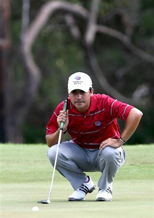 PERTH, AUSTRALIA - FEBRUARY 21:  Felipe Aguilar of Chile lines up his putt on the 4th green during round three of the 2009 Johnnie Walker Classic at The Vines Resort and Country Club on February 21, 2009 in Perth, Australia.  (Photo by Paul Kane/Getty Images)