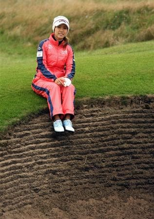 LYTHAM ST ANNES, ENGLAND - JULY 29:  Momoko Ueda of Japan poses for a picture by the fairway bunker on the 15th during practice prior to the 2009 Ricoh Women's British Open Championship held at Royal Lytham St Annes Golf Club, on July 29, 2009 in Lytham St Annes, England.  (Photo by Warren Little/Getty Images)