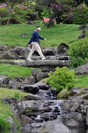 JEJU, SOUTH KOREA - APRIL 24: Gonzalo Fernandez - Castano of Spain walks over a bridge during the second round of the Ballantine's Championship at Pinx Golf Club on April 24, 2009 in Jeju, South Korea.  (Photo by Stuart Franklin/Getty Images)