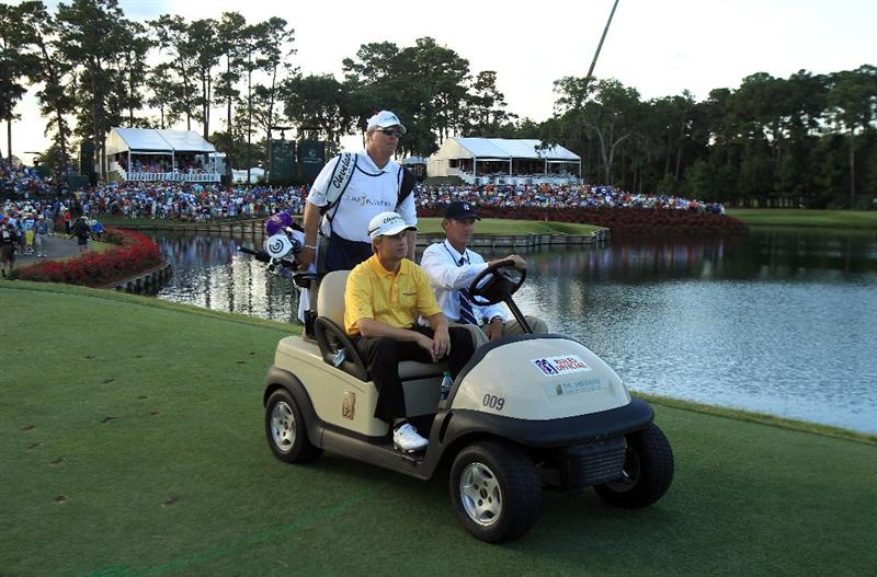 PONTE VEDRA BEACH, FL - MAY 15:  David Toms is driven in a golf cart to the first playoff hole during the final round of THE PLAYERS Championship held at THE PLAYERS Stadium course at TPC Sawgrass on May 15, 2011 in Ponte Vedra Beach, Florida.  (Photo by Streeter Lecka/Getty Images)