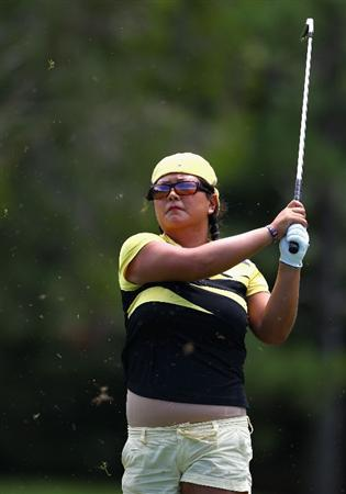 GOLD COAST, AUSTRALIA - MARCH 04:  Christina Kim of the USA plays an iron shot on the 8th hole during round one of the 2010 ANZ Ladies Masters at Royal Pines Resort on March 4, 2010 in Gold Coast, Australia.  (Photo by Ryan Pierse/Getty Images)