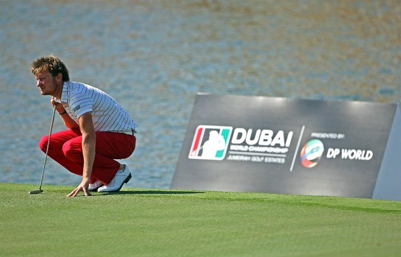 DUBAI, UNITED ARAB EMIRATES - NOVEMBER 19:  Chris Wood of England lines up a putt on the 16th hole during the first round of the Dubai World Championship on the Earth Course, Jumeirah Golf Estates on November 19, 2009 in Dubai, United Arab Emirates.  (Photo by Andrew Redington/Getty Images)