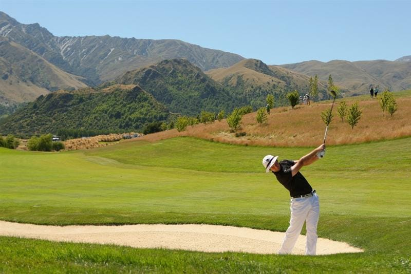 QUEENSTOWN, NEW ZEALAND - JANUARY 29:  Doug Batty of New Zealand plays out of a bunker on the 13th hole during day two of the New Zealand Open at The Hills Golf Club on January 29, 2010 in Queenstown, New Zealand.  (Photo by Phil Walter/Getty Images)