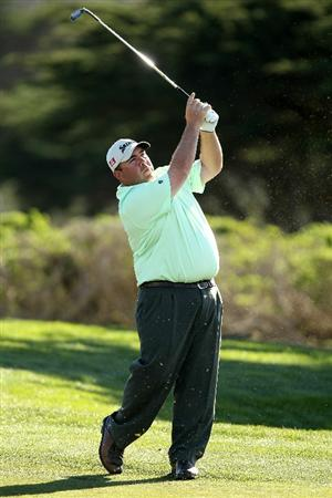 PEBBLE BEACH, CA - FEBRUARY 11:  Kevin Stadler hits his second shot on the 15th hole during the second round of the AT&T Pebble Beach National Pro-Am at Monterey Peninsula Country Club on February 11, 2011 in Pebble Beach, California.  (Photo by Ezra Shaw/Getty Images)