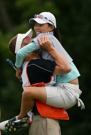 GLADSTONE, NJ - MAY 23: Sun Young Yoo of South Korea is picked up by her caddie Kurt Kowaluk after winning the Sybase Match Play Championship at Hamilton Farm Golf Club on May 23, 2010 in Gladstone, New Jersey. (Photo by Hunter Martin/Getty Images)