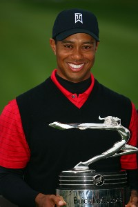 Tiger Woods smiles with the winner's trophy after his 19 under par victory during the final round of the Buick Invitational on January 27, 2008 at the Torrey Pines Golf Course in  La Jolla, California. PGA TOUR - 2008 Buick Invitational - Final RoundPhoto by Donald Miralle/Getty Images