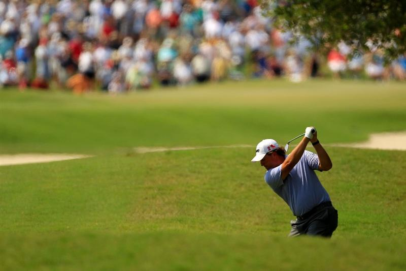 PONTE VEDRA BEACH, FL - MAY 13:  Phil Mickelson hits an approach shot on the second hole during the second round of THE PLAYERS Championship held at THE PLAYERS Stadium course at TPC Sawgrass on May 13, 2011 in Ponte Vedra Beach, Florida.  (Photo by Streeter Lecka/Getty Images)