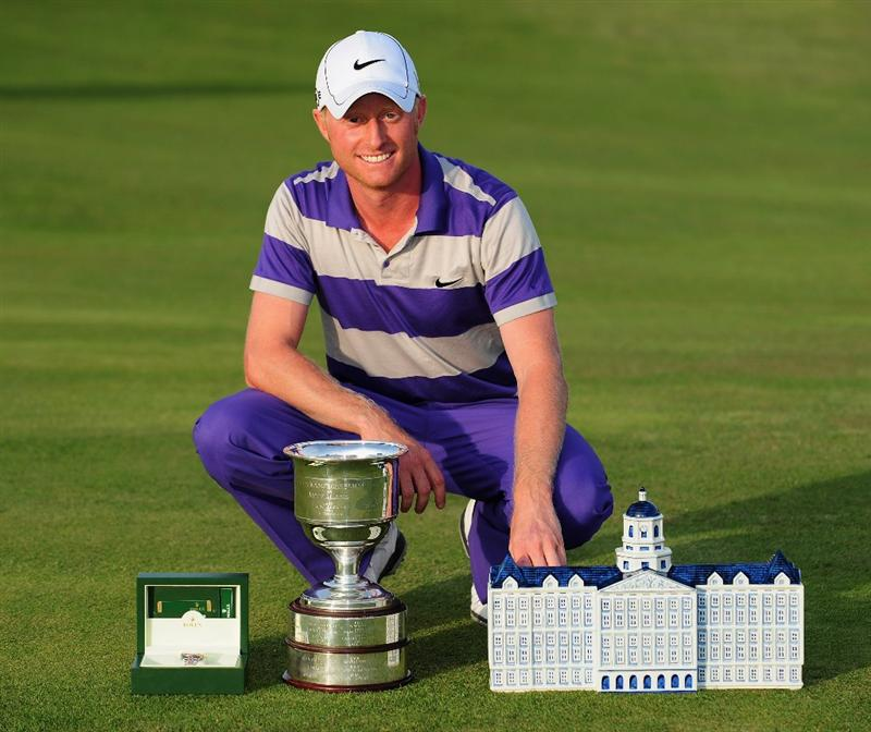ZANDVOORT, NETHERLANDS - AUGUST 23:  Simon Dyson of England with the winners trophy after winning in a playoff against Peter Lawrie of Ireland and Peter Hedblom of Sweden during the final round of The KLM Open at Kennemer Golf & Country Club on August 23, 2009 in Zandvoort, Netherlands.  (Photo by Stuart Franklin/Getty Images)