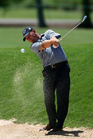 AVONDALE, LA - APRIL 25:  Jason Bohn hits his second shot on the 7th hole during the final round of the Zurich Classic at TPC Louisiana on April 25, 2010 in Avondale, Louisiana.  (Photo by Chris Trotman/Getty Images)