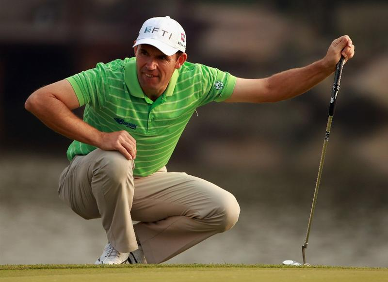 SHANGHAI, CHINA - NOVEMBER 06:  Padraig Harrington of Ireland lines up a putt on the 18th hole during the third round of the WGC-HSBC Champions at Sheshan International Golf Club on November 6, 2010 in Shanghai, China.  (Photo by Andrew Redington/Getty Images)