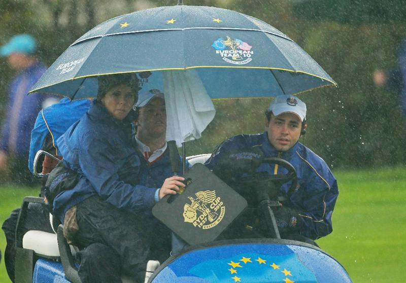 NEWPORT, WALES - OCTOBER 01:  Rory McIlroy of Europe rides with his partner Holly Sweeney during the Morning Fourball Matches during the 2010 Ryder Cup at the Celtic Manor Resort on October 1, 2010 in Newport, Wales.  (Photo by Andrew Redington/Getty Images)