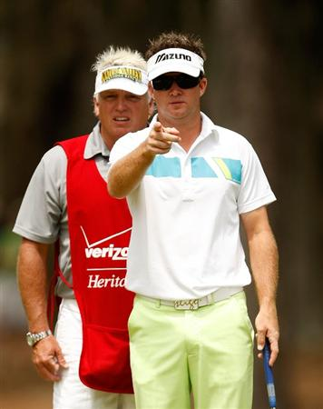 HILTON HEAD ISLAND, SC - APRIL 19:  Brian Gay and his caddie Kip Henley line up a putt on the 2nd hole during the final round of the Verizon Heritage at Harbour Town Golf Links on April 19, 2009 in Hilton Head Island, South Carolina.  (Photo by Streeter Lecka/Getty Images)