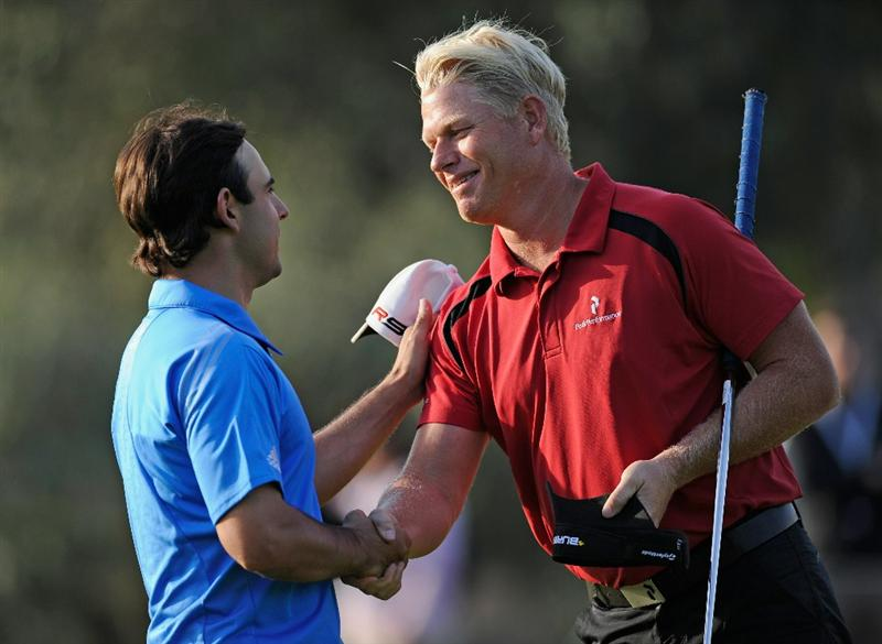 CASTELLON DE LA PLANA, SPAIN - OCTOBER 22:  Peter Hedblom of Sweden shakes hands with playing partner  Fabrizio Zanotti of Paraguay on the nineth hole during the second round of the Castello Masters Costa Azahar at the Club de Campo del Mediterraneo on October 22, 2010 in Castellon de la Plana, Spain.  (Photo by Stuart Franklin/Getty Images)