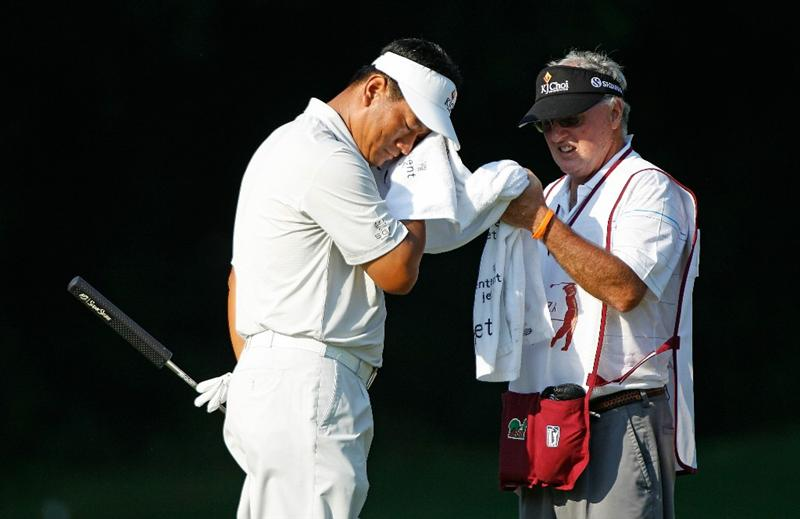 FT. WORTH, TX - MAY 27:  K.J. Choi of South Korea wipes sweat from his face as his caddie Andy Prodger looks on during the first round of the 2010 Crowne Plaza Invitational at the Colonial Country Club on May 27, 2010 in Ft. Worth, Texas  (Photo by Scott Halleran/Getty Images)