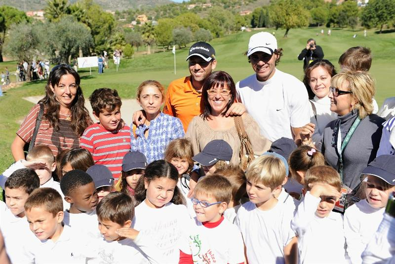 CASTELLON DE LA PLANA, SPAIN - OCTOBER 20:  Sergio Garcia of Spain and playing partner, tennis star, Rafael Nadal of Spain meet local children during the pro - am prior to the start of the Castello Masters Costa Azahar at the Club de Campo del Mediterraneo on October 20, 2010 in Castellon de la Plana, Spain.  (Photo by Stuart Franklin/Getty Images)