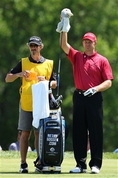 BLOOMFIELD HILLS, MI - AUGUST 09:  Retief Goosen of South Africa (R) pulls a club from his bag alongside caddie Colin Byrne (L) during round three of the 90th PGA Championship at Oakland Hills Country Club on August 9, 2008 in Bloomfield Township, Michigan.  (Photo by Stuart Franklin/Getty Images)