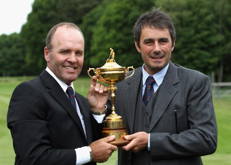VIRGINIA WATER, ENGLAND - MAY 17:  Past Ryder Cup players Thomas Levet and Jean Van de Velde of France proudly hold the Ryder Cup as the French bid won the right to hold the 2018 Ryder Cup at Golf National in Paris, during a press conference at Wentworth on May 17, 2011 in Virginia Water, England.  (Photo by Bryn Lennon/Getty Images)