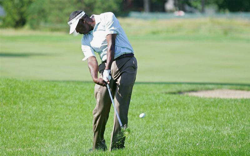 CROMWELL, CT - JUNE 25:  Vijay Singh of Fiji Islands hits a shot from the rough during the second round of the Travelers Championship held at TPC River Highlands on June 25, 2010 in Cromwell, Connecticut.  (Photo by Michael Cohen/Getty Images)