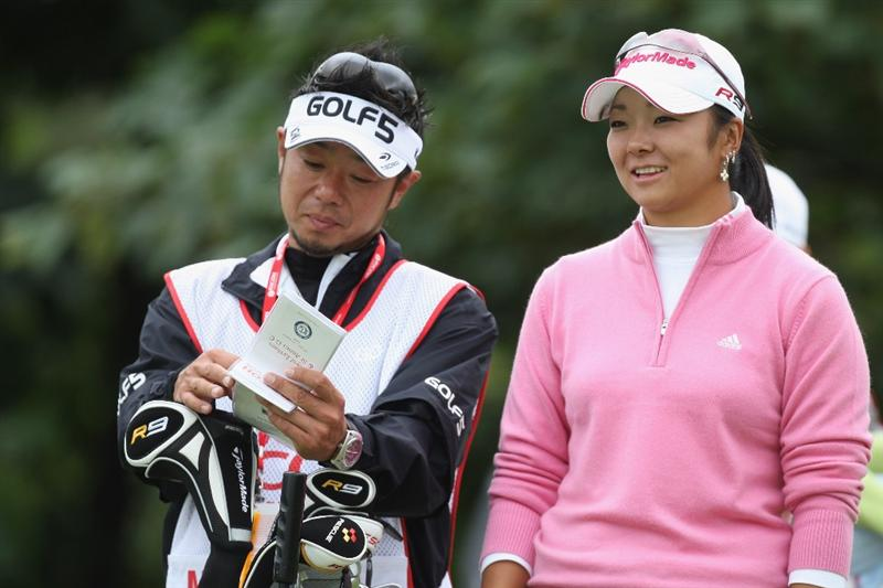 LYTHAM ST ANNES, ENGLAND - JULY 31:  Yuko Mitsuka of Japan waits to tee off on the 12th hole with her caddie during the second round of the 2009 Ricoh Women's British Open Championship held at Royal Lytham St Annes Golf Club, on July 31, 2009 in  Lytham St Annes, England.  (Photo by David Cannon/Getty Images)