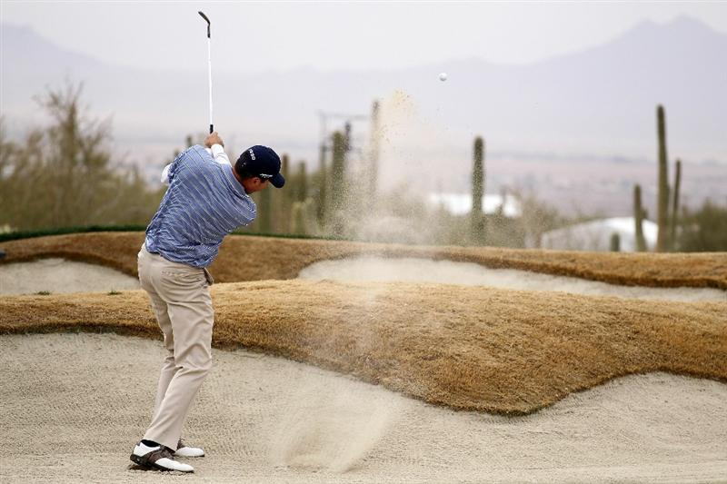 MARANA, AZ - FEBRUARY 26:  Matt Kuchar plays his second shot on the tenth hole from a bunker during the semifinal round of the Accenture Match Play Championship at the Ritz-Carlton Golf Club on February 26, 2011 in Marana, Arizona.  (Photo by Andy Lyons/Getty Images)