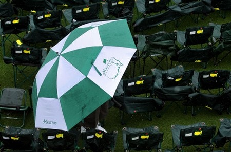 AUGUSTA, GA - APRIL 12:  A patron waits under an umbrella near the second hole during the third round of the 2008 Masters Tournament at Augusta National Golf Club on April 12, 2008 in Augusta, Georgia.  (Photo by Harry How/Getty Images)