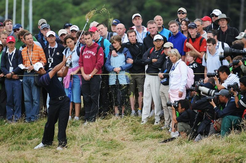 TURNBERRY, SCOTLAND - JULY 16:  Tiger Woods of USA plays a shot from the rough on the 2nd hole during round one of the 138th Open Championship on the Ailsa Course, Turnberry Golf Club on July 16, 2009 in Turnberry, Scotland.  (Photo by Harry How/Getty Images)