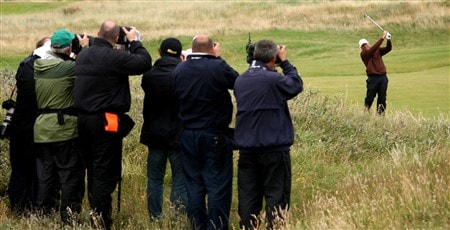 SOUTHPORT, UNITED KINGDOM - JULY 18:  Photographers capture Greg Norman of Australia as he plays his second shot on the 16th during the second round of the 137th Open Championship on July 18, 2008 at Royal Birkdale Golf Club, Southport, England.  (Photo by Ross Kinnaird/Getty Images)