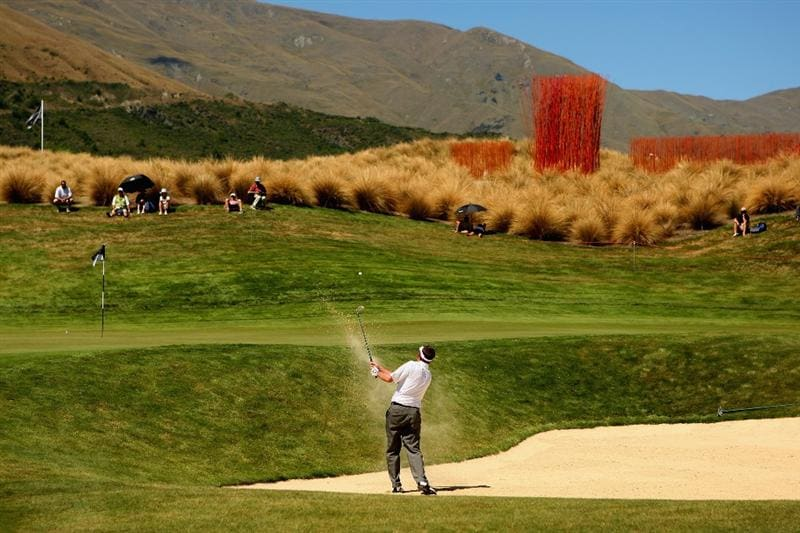 QUEENSTOWN, NEW ZEALAND - JANUARY 29:  Jim Herman of the USA plays out of a bunker on the 13th hole during day two of the New Zealand Open at The Hills Golf Club on January 29, 2010 in Queenstown, New Zealand.  (Photo by Phil Walter/Getty Images)