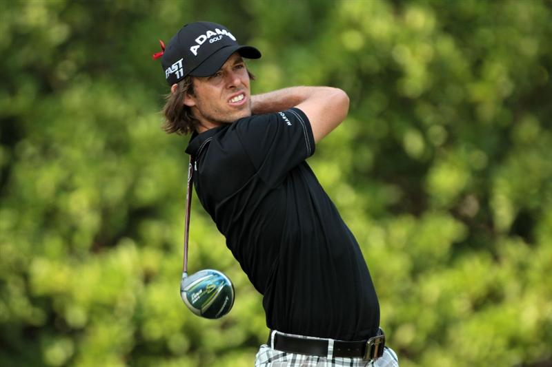 PONTE VEDRA BEACH, FL - MAY 12:  Aaron Baddeley of Australia htis his tee shot on the 11th hole during the first round of THE PLAYERS Championship held at THE PLAYERS Stadium course at TPC Sawgrass on May 12, 2011 in Ponte Vedra Beach, Florida.  (Photo by Scott Halleran/Getty Images)