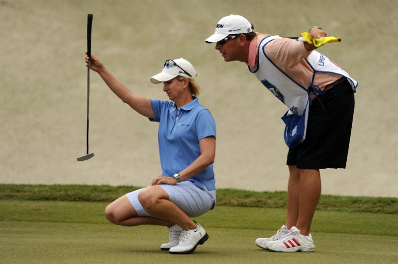 WEST PALM BEACH, FL - NOVEMBER 23:  Karrie Webb of Australia lines up her putt on hole number 9 during the final round of the ADT Championship at the Trump International Golf Club on November 23, 2008 in West Palm Beach, Florida.  (Photo by Montana Pritchard/Getty Images)
