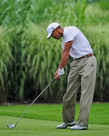 AKRON, OH - AUGUST 08:  Tiger Woods of USA plays his tee shot on the 16th hole during the third round of the World Golf Championship Bridgestone Invitational on August 8, 2009 at Firestone Country Club in Akron, Ohio.  (Photo by Stuart Franklin/Getty Images)