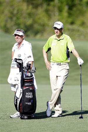HUMBLE, TX - MARCH 31:  Ross Fisher of England (R) stands by his golf bag during the first round of the Shell Houston Open at Redstone Golf Club on March 31, 2011 in Humble, Texas.  (Photo by Michael Cohen/Getty Images)